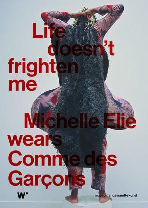 Life doesn't frighten me. Michelle Elie wears Comme des Garçons von Ifeoma Kupka,  Mahret, Wagner,  Matthias